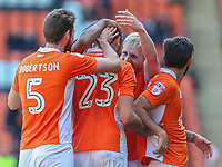 Blackpool's Mark Cullen celebrates scoring his sides first goal with teammates Clark Robertson, Colin Daniel and Jack Payne<br /> <br /> Photographer Alex Dodd/CameraSport<br /> <br /> The EFL Sky Bet League Two - Blackpool v Cheltenham Town - Saturday 22nd April 2017 - Bloomfield Road - Blackpool<br /> <br /> World Copyright &copy; 2017 CameraSport. All rights reserved. 43 Linden Ave. Countesthorpe. Leicester. England. LE8 5PG - Tel: +44 (0) 116 277 4147 - admin@camerasport.com - www.camerasport.com