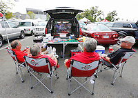 Sidney, Ohio golf buddies, from left, Frank Ruggiero, Cott Wenger, Mich Given and Mike Greve watch the University of Florida against University of Miami football game while tailgating prior to the Ohio State NCAA football game against San Diego State at Ohio Stadium in Columbus on Sept. 7, 2013. (Adam Cairns / The Columbus Dispatch)