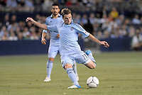 Bobby Convey (11) midfield Sporting KC shoots on goal..Sporting Kansas City and New England Revolution played to a 0-0 tie at LIVESTRONG Sporting Park, Kansas City, KS.
