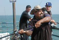 Jose Hernandez casts his line during the 17th Annual Santa Monica Pier Father?s Day Fishing Derby on Sunday, June 17, 2007. He won the competition with a 21-pound Leopard Shark.