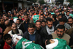 .Palestinians carry the bodies of senior Hamas leader Nizar Rayyan and his family, who were killed in an Israeli air strike on their home on Thursday, during their funeral in Jabalya in the northern Gaza Strip. APAIMAGES PHOTO / Ashraf Amra