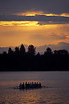 Sunrise on the Montlake Cut with eight man crew rowing stormy weather