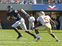 Oct 2, 2010; Charlottesville, VA, USA; Virginia Cavaliers wide receiver Dontrelle Inman (81) runs past Florida State Seminoles cornerback Greg Reid (5) during the game at Scott Stadium. Florida State won 34-14.  Mandatory Credit: Andrew Shurtleff-