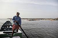 A fisherman at the fishing harbour of Chowra beach near Kovalam, Trivandrum, Kerala, India.