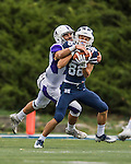 8 October 2016: Middlebury College Panther Wide Receiver Conrado Banky, a Sophomore from Katy, Texas, holds onto the ball as Amherst College Defensive Back John Rak, a Sophomore from Los Altos, CA, makes the tackle during a game at Alumni Stadium in Middlebury, Vermont. The Panthers edged out the Purple & While 27-26. Mandatory Credit: Ed Wolfstein Photo *** RAW (NEF) Image File Available ***