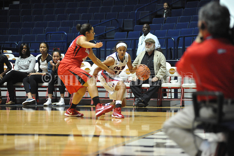 Ole Miss' Diara Moore (10) vs. Lamar's Jasmin Henderson (44) in women's college basketball at the C.M. &quot;Tad&quot; Smith Coliseum in Oxford, Miss. on Monday, November 19, 2012.  Lamar won 85-71.