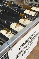 muscat bottles stored in wire cages altenberg de bergbieten gc dom frederic mochel traenheim alsace france