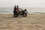 Couple riding a Quad on the playa near Migrino, Baja California, Mexico