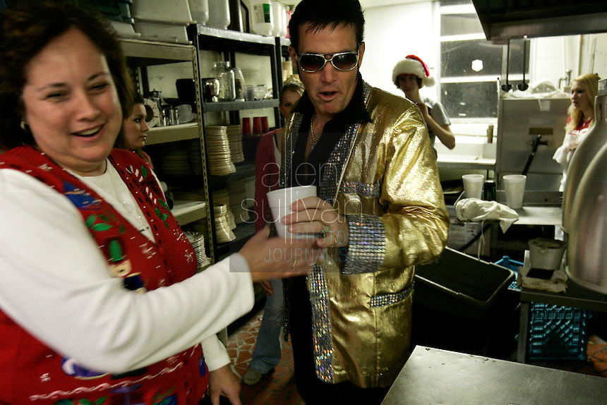 Mike Jones becomes Elvis Presley at The Lantern Inn, his family's restaurant in Gainesville, Ga., on Saturday, Dec. 16, 2006. Jones, 46 and a cook, has been performing as Elvis at the eatery for 18 years, but Saturday was the curtain call. The Lantern Inn closed its doors on Sunday after over 40 years of business.<br />