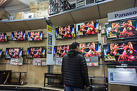 """Last minute shoppers browse flat screen televisions in a Best Buy store in the borough of Queens in New York on Saturday, December 22, 2012 looking for bargains. """"Super Saturday"""", the Saturday prior to Christmas, is the second busiest shopping day of the year.  (© Richard B. Levine)"""