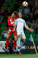 Melbourne, 28 October 2016 - JORDAN O'DOHERTY (24) of Adelaide and EMMANUEL MUSCAT (2) of Melbourne City jump for the ball in the round 4 match of the A-League between Melbourne City and Adelaide United at AAMI Park, Melbourne, Australia. Melbourne won 2-1 (Photo Sydney Low / sydlow.com)