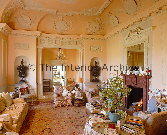 The walls and ceiling of this formal drawing room are decorated with elaborate plaster mouldings and bas reliefs