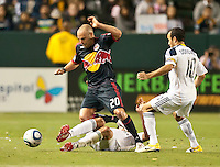 CARSON, CA – May 7, 2011: New York Red Bull midfielder Joel Lindpere (20) tries to get past LA Galaxy defender Omar Gonzalez (4) and midfielder Landon Donovan (10) during the match between LA Galaxy and New York Red Bull at the Home Depot Center, May 7, 2011 in Carson, California. Final score LA Galaxy 1, New York Red Bull 1.