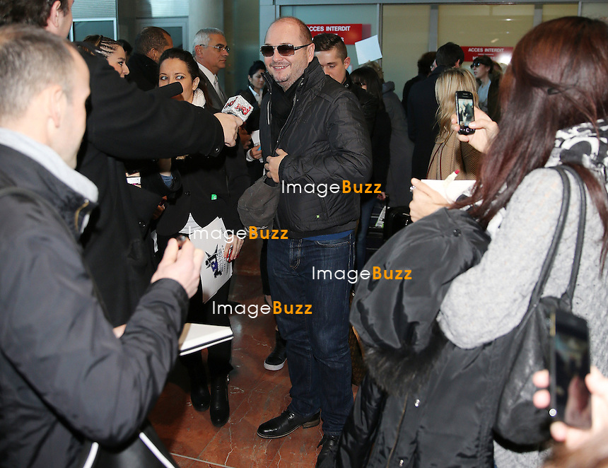 S&eacute;bastien Cauet arrives at Nice airport for the NRJ MUSIC AWARDS 2014.<br /> December 13, 2013.