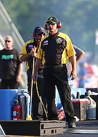 Jun 3, 2016; Epping , NH, USA; NHRA official starter Mike Gittings during qualifying for the New England Nationals at New England Dragway. Mandatory Credit: Mark J. Rebilas-USA TODAY Sports