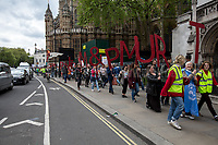 London, 29/04/2017. Today, &quot;Campaign Against Climate Change&quot; held a demonstration started at Old Palace Yard and ended on Westminster Bridge, where people formed a human chain showing the message: &quot;Trump &amp; May Climate Disaster&quot;. The demonstration was in support and solidarity with the People's Climate March in the US (and over 350 other marches taking place across the globe) and to warn the British Prime Minister Theresa May to stop following Donald Trump &quot;down the path to climate disaster&quot;.<br />   <br /> For more information please click here: https://www.facebook.com/events/747422225425039/ &amp; (Video) https://www.facebook.com/campaigncc/videos/1300562783385237/ &amp; (Press Release) http://www.campaigncc.org/node/1782