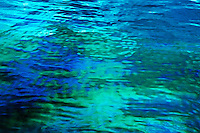 Iridescent oil floating on the surface of the water, Maldives.