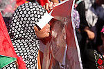 A Palestinian woman kisses a portrait of Turkish President Recep Tayyip Erdogan during a mass wedding ceremony in Gaza City, on May 31, 2015. Nearly 2000 Palestinian couples were married in a ceremony funded by the Turkish government and supported by the Hamas movement. Photo by Ashraf Amra