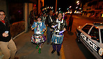 The March Madness Marching Band, a local Lexington group, marches outside the Mardi Gras celebration at Bourbon and Toulouse in Lexington, Ky., on Tuesday, February 12, 2013. Photo by Genevieve Adams | Staff