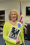 "Garden City, New York, USA. April 17, 2016. JANE KRIEGER, a campaign volunteer for Democratic presidential primary candidate Hillary Clinton, is holding an autographed photo of Jon ""Bowzer"" Bauman of the band Sha Na Na, at the Canvass Kickoff at the Nassau County Democratic Office. Bauman attended the campaign event to explain why it's important to GOTV Get Out The Vote for Hillary, and he signed photos of himself for the volunteers."