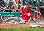 21 March 2015: Washington outfielder Michael Taylor slides home safely in the 3rd inning during a Spring Training Split Squad game against the Atlanta Braves at Champion Stadium at the ESPN Wide World of Sports Complex in Kissimmee, Florida. The Braves defeated the Nationals 5-2 in Grapefruit League play. Mandatory Credit: Ed Wolfstein Photo *** RAW (NEF) Image File Available ***