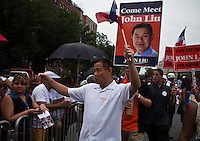 Mayoral candidate John Liu takes part during the Bronx Dominican parade in New York July 28, 2013 by Kena Betancur / VIEWpress