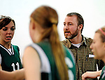 8 November 2009: Enosburg coach Jason Robtoy encourages his athletes in the 2009 High School Volleyball State Championships hosted by Vermont Commons School at the Sports and Fitness Edge in South Burlington, Vermont. The Enosburg Falls Hornets successfully defended their boys' title while the VCS Flying Turtles rallied to maintain their girls' team crown. Mandatory Credit: Ed Wolfstein Photo
