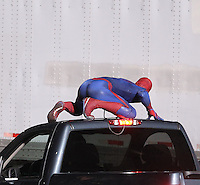 January 24th 2011  Los Angeles, CA. ***EXCLUSIVE*** The untitled Spider-Man Reboot movie continues filming an action sequence on the streets of Downtown LA. In this scene, Spider_Man is being chased by the NYPD as he runs through city traffic. Spidey then jumps into the back of a pick up truck then leaps onto tractor trailer and climbs the side of it on to the roof and rides away into the darkness of the night. Spider-Man was assisted by Velcro and a wire to stick to and climb up the side of the tractor trailer. Before the scene a crew member is seen attaching Velcro to Spidey's feet..Photo by Eric Ford / On Location News 818-613-3955  info@onlocationnews.com