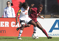 COLLEGE PARK, MD - OCTOBER 21, 2012:  Shade Pratt (22) of the University of Maryland keeps the ball away from Jessica Price (6) of Florida State during an ACC women's match at Ludwig Field in College Park, MD. on October 21. Florida won 1-0.
