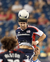 New England Revolution defender Stephen McCarthy (26) heads the ball. In a Major League Soccer (MLS) match, Montreal Impact defeated the New England Revolution, 1-0, at Gillette Stadium on August 12, 2012.