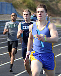 SEYMOUR CT. 18 April 2017-041817SV09-Trae Lounsbury of Seymour High finishes the 4x100 in 1st place along side Jack Kolvig of Oxford High, 2nd place, and Maleek Dawkins of Wilby High, 3rd place, during NVL track action at Seymour High in Seymour Tuesday.<br /> Steven Valenti Republican-American