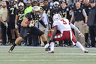 Annapolis, MD - December 27, 2016: Wake Forest Demon Deacons tight end Cam Serigne (85) tries to run by Temple Owls defensive back Sean Chandler (3) during game between Temple and Wake Forest at  Navy-Marine Corps Memorial Stadium in Annapolis, MD.   (Photo by Elliott Brown/Media Images International)