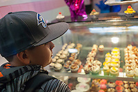 Sprinkle Splash Sweet Shoppe becomes the newest addition to the shops located in La Marqueta in East Harlem in New York, seen on its opening day, Saturday, April 2, 2016. Besides the incubator kitchen in the building there are a number of retail spaces in the revitalized facility rented by the entrepreneurs and small businesses which use the kitchen. (© Richard B. Levine)