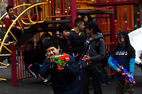 Children plays with gang toys at Manhattan's Chinatown in New York, Nov 11, 2013. VIEWpress/Eduardo Munoz Alvarez