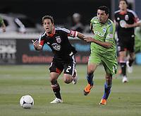 D.C. United midfielder Danny Cruz (2) shields the ball against Seattle Sounder defender Leo Gonzalez (12)  D.C. United tied The Seattle Sounders 0-0 at RFK Stadium, Saturday April 7 , 2012.