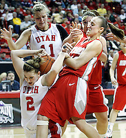 Utah forward Kalee Whipple fights for control of the ball with New Mexico guard Sara Halasz  as Utah forward Taryn Wicijowski looks on (back left) the University of Utah women's basketball defeated New Mexico in overtime to advance in the Mountain West Conference basketball Championship Tournament at the Thomas &amp; Mack Center in Las Vegas, Nevada Wednesday, March 10, 2010.  August Miller, Deseret News .