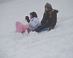 Ann Morgan Sullivan (left) and Kate Anderson sled in the snow in Oxford, Miss., on Monday, January 10, 2011.