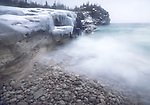 Frozen rocks on a shore of Georgian Bay in winter. Lanscape nature scenery. Bruce peninsula, Ontario, Canada.