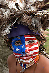 Portrait young Native American boy with American flag painted on his face at Thunderbird Pow-Wow in Queens County Farm, New York.<br />