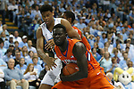 30 December 2015: Clemson's Sidy Djitte (SEN) (front) grabs a rebound from North Carolina's Isaiah Hicks (behind). The University of North Carolina Tar Heels hosted the Clemson University Tigers at the Dean E. Smith Center in Chapel Hill, North Carolina in a 2015-16 NCAA Division I Men's Basketball game. UNC won the game 80-69.