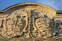 Detail of a relief of Castilian coat of arms, Auberge de Castille (Il-Berga ta' Kastilja), 1571, Valletta, Malta, pictured on June 7, 2008, in the afternoon.  The Republic of Malta consists of seven islands in the Mediterranean Sea of which Malta, Gozo and Comino have been inhabited since c.5,200 BC. Nine of Malta's important historical monuments are UNESCO World Heritage Sites, including  the capital city, Valletta, also known as the Fortress City. Built in the late 16th century and mainly Baroque in style it is named after its founder Jean Parisot de Valette (c.1494-1568), Grand Master of the Order of St John. The Knights of St John built an auberge, or inn, for each nationality of knight who passed through Malta. This one, for Castilians, was designed by Girolamo Cassar, and re-modelled in 1741, probably by Andrea Belli. It is now the Prime Minister's office. Picture by Manuel Cohen.