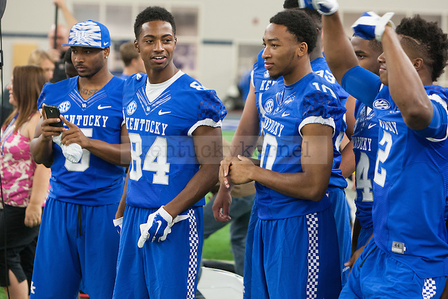 A group of players cheer and dance during UK football media day at Nutter Field House in Lexington, Ky., on Friday, August 8, 2014. Photo by Adam Pennavaria | Staff