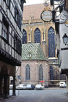 Colmar: View between buildings and church.