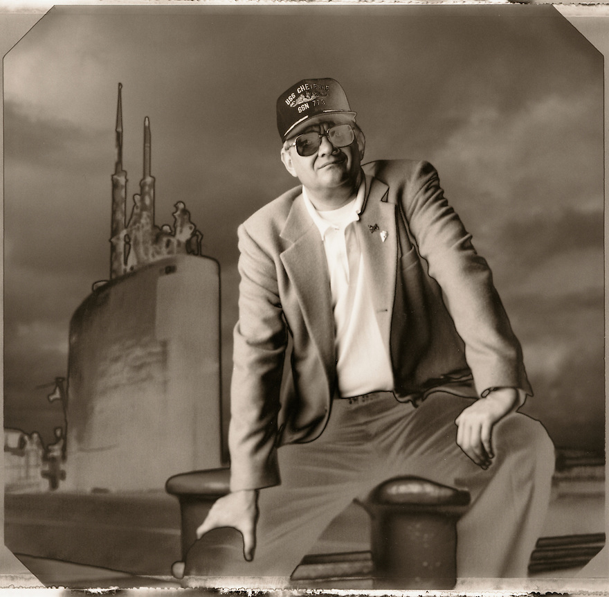 Author Tom Clancy photographed beside a nuclear submarine for Entertainment Weekly magazine.