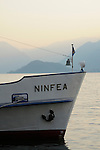 A ferry boat, the Ninfea, on Lake Como, Italy at dusk.