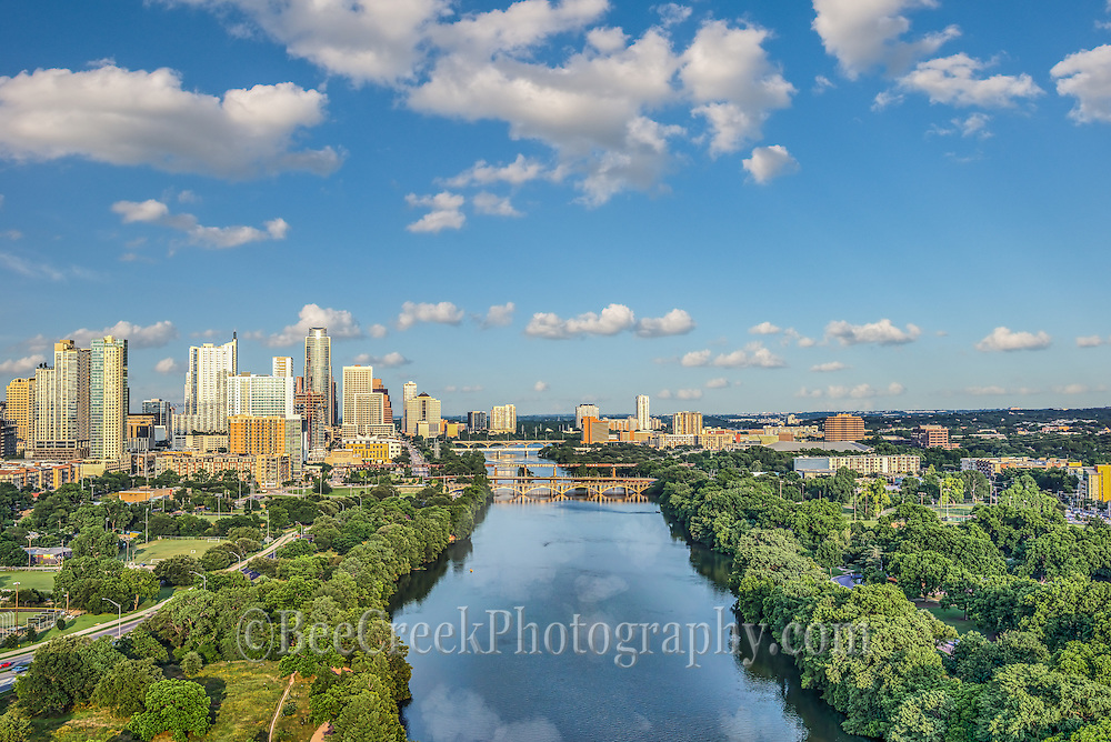 Another aerial view of downtown Austin from Zilker park with LadyBird Lake along with the Lamar street bridge, first street bridge and congress bridges that cross the lake.  On this day they were letting water downstream so it was one of those rare days without anyone on the lake.