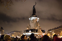 A view of the monument and demonstrators at Place de la Republique following the massacre at Charlie Hebdo in Paris where masked gunmen killed 12 people. Paris, France, (Jan. 7, 2015).