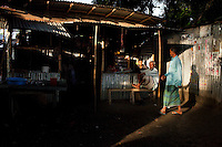 Men congregate at a roadside tea stall to while their time after a day of work in rural Bangladesh near Bogra, northern Bangladesh on 19th September 2011. Photo by Suzanne Lee for The Guardian