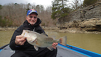 NWA Democrat-Gazette/FLIP PUTTHOFF <br /> Keith Brashers of Rogers shows a largemouth bass he caught at Beaver Lake March 18, 2016 from muddy water in the Ventris arm. Dirty water means anglers can use heavier line and larger lures than when the lake is clear.
