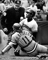Giants Jose Uribe is safe at home after knocking the ball loose from Reds catcher Dan Bilardello. Umpire is Dick Stello. (1985 photo by Ron Riesterer)